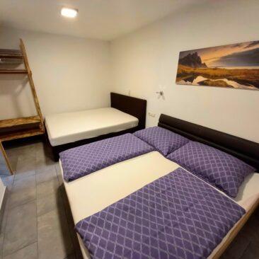 Dreibettschlafzimmer Appartement NR1